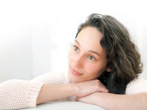 Portrait of an attractive thinking girl with curly hair Stock Images