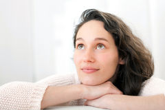 Portrait of an attractive thinking girl with curly hair Stock Photography