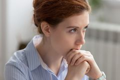 Portrait of attractive thoughtful businesswoman planning, thinking about solving problem royalty free stock image