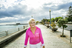 Portrait of attractive tourist walking along the promenade Stock Photography