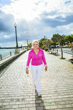Portrait of attractive tourist walking along the promenade Royalty Free Stock Photography