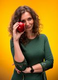 Portrait of an attractive woman with an apple Royalty Free Stock Images