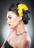 Portrait of a attractive woman with beautiful eyes and flowers in her hair Stock Photos
