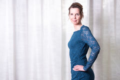 Portrait attractive woman in blue dress Royalty Free Stock Images