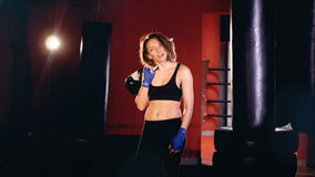 Portrait. Attractive woman boxer in boxing gym. stock footage
