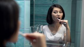 Portrait of attractive woman brushing teeth stock video footage