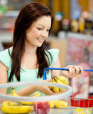 Portrait of an attractive woman buying fruits Royalty Free Stock Image