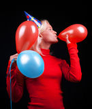 Portrait of attractive woman celebrating. Portrait of attractive happy woman with balloons celebrating Royalty Free Stock Image