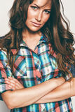 Portrait of attractive woman in check shirt. In studio Royalty Free Stock Images