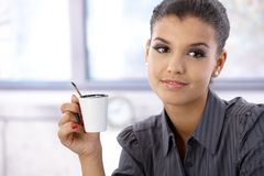 Portrait of attractive woman with coffee cup Royalty Free Stock Photography