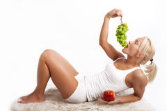 Portrait of a attractive woman eating fruit Stock Photography