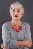 Portrait of attractive woman with gray hair stock photography