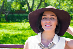 Portrait of an attractive woman with the hat in the Park on a sunny day Royalty Free Stock Photos