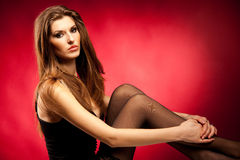 Portrait of attractive woman isolated in studio Stock Image
