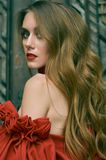 Portrait of an attractive woman with long flowing hair in red. Fashion photo royalty free stock photography
