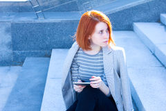 Portrait of attractive woman looking to the side with the tablet. Portrait of a woman looking to the side with the tablet Stock Photos