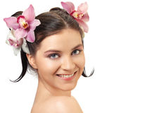 Portrait of attractive woman with orchids in her hairstyle. royalty free stock photos