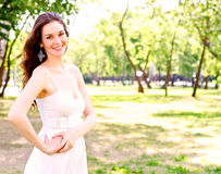 Portrait of an attractive woman in the park Stock Photo