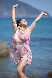 Portrait of attractive woman in sarong at sea Royalty Free Stock Photography