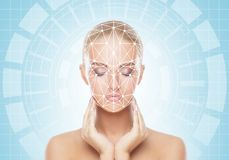 Portrait of attractive woman with a scnanning grid on her face. Face id, security, facial recognition, future technology royalty free stock photo