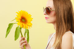 Portrait attractive woman with sunflower Stock Photos