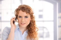 Portrait of attractive woman using mobile phone Stock Photo