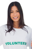 Portrait of an attractive woman wearing volunteer tshirt Stock Photography