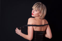 Portrait of attractive woman with a whip in his hand Stock Image
