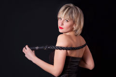 Portrait of attractive woman with a whip in his hand Royalty Free Stock Image