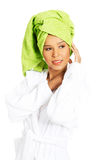 Portrait of attractive woman wrapped in towel with turban on hea. D. Bust. Isolated on white Royalty Free Stock Photography