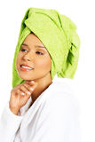 Portrait of attractive woman wrapped in towel with turban on hea Stock Photography