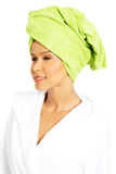 Portrait of attractive woman wrapped in towel with turban on hea Stock Images