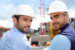 Portrait of an attractive worker and an architect on a construct Stock Photography