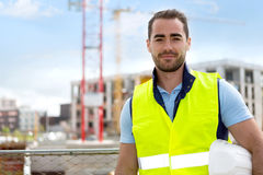Portrait of an attractive worker on a construction site Royalty Free Stock Photos