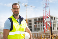 Portrait of an attractive worker on a construction site Royalty Free Stock Photo