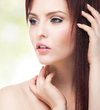 Portrait of attractive young adult woman. Head and shoulders composition, hands visible Royalty Free Stock Photo