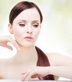 Portrait of attractive young adult woman. Head and shoulders composition, hands visible Stock Images