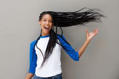 Attractive young african american woman with long braided hair on gray background Royalty Free Stock Image