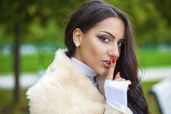 Portrait of attractive young arabic woman with finger on lips. Portrait of attractive arabic girl with finger on lips, concept of student show quiet, silence Stock Images