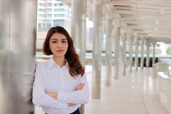 Portrait of attractive young Asian businesswoman looking confident posing outside on urban background. Leadership woman concept. Portrait of attractive young Royalty Free Stock Photos