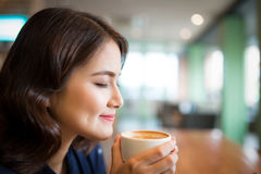 Portrait of attractive young asian woman drinking coffee.  Stock Photos