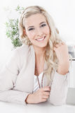 Portrait of a attractive young blond woman Royalty Free Stock Photos