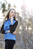 Portrait of attractive young blonde girl looking away - Royalty Free Stock Photography