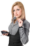 Portrait of attractive young blonde with smartphone. Isolated Stock Photos