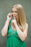 Portrait of attractive young blonde woman with finger on lips. Portrait of attractive girl with finger on lips, concept of student show quiet, silence, secret Royalty Free Stock Image