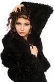Portrait of attractive young brunette in black coat Royalty Free Stock Image