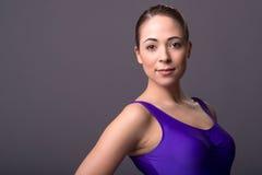 Portrait of attractive young brunette female dancer, on dark background Stock Image