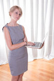 Portrait attractive young business woman with laptop Stock Image