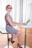 Portrait attractive young business woman with laptop Royalty Free Stock Photos