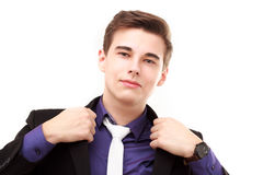Portrait of an attractive young businessman correcting his jacke Stock Photography